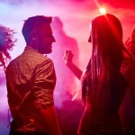 45115681 - happy couple and their friends dancing in disco club